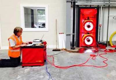 What is a Blower Door Test and why is it required as partof the Legalett HVAC design package?
