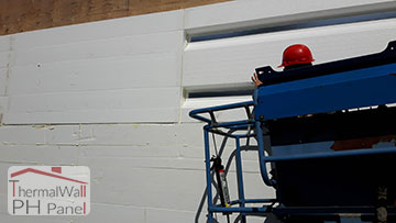 4.Set the ThermalWall PH Passive House Insulated Wall Panel into the foam adhesive